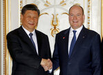 Chinese President Xi Jinping, left, and Prince Albert II of Monaco shake hands as they pose for photographers at Monaco Palace, Sunday, March 24, 2019. Xi is paying the first state visit by a Chinese president to the tiny Mediterranean principality of Monaco on Sunday. (Eric Gaillard/Pool Photo via AP)