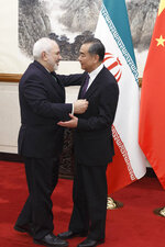 Chinese Foreign Minister Wang Yi meets Iranian Foreign Minister Mohammad Javad Zarif at Chinese Foreign Minister Wang Yi meets Iranian Foreign Minister Mohammad Javad Zarif at the Diaoyutai State Guesthouse in Beijing, Friday, May 17, 2019. (Thomas Peter/Pool Photo via AP)