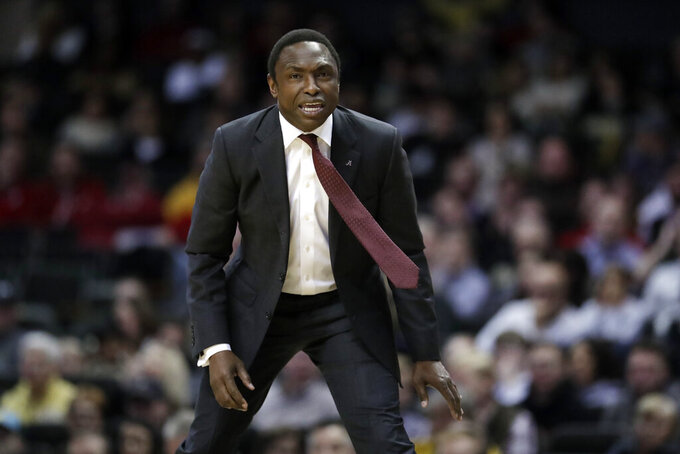 FILE - In this Feb. 9, 2019, file photo, Alabama head coach Avery Johnson watches the action in the second half of an NCAA college basketball game against Vanderbilt, in Nashville, Tenn. Alabama has beaten one Top 5 team and pushed another down to the wire on the road and also suffered some humbling defeats.  That inconsistency has left the Crimson Tide (15-11, 6-7 Southeastern Conference) in a precarious position in the team's bid to make a second straight NCAA Tournament. (AP Photo/Mark Humphrey, File)