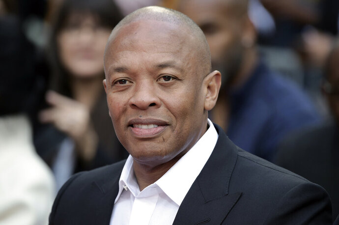 """FILE - Dr. Dre attends a hand and footprint ceremony honoring Quincy Jones on Nov. 27, 2018, in Los Angeles. In a social media post late Tuesday, Jan. 5, 2021, Dr. Dre said he will be """"back home soon"""" after the music mogul received medical treatment at a Los Angeles hospital for a reported brain aneurysm. (Photo by Richard Shotwell/Invision/AP, File)"""
