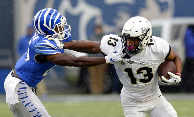 Central Florida wide receiver Gabriel Davis (13) pushes away Memphis defensive back Tito Windham (24) after catching a pass during the second half of an NCAA college football game Saturday, Oct. 13, 2018, in Memphis, Tenn. Central Florida won 31-30. (AP Photo/Mark Zaleski)