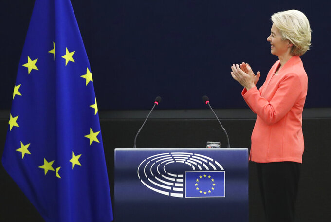 European Commission President Ursula von der Leyen applauds after delivering a State of the Union Address at the European Parliament in Strasbourg, France, Wednesday, Sept. 15, 2021. Stung by the swift collapse of the Afghan army and the chaotic U.S.-led evacuation through Kabul airport, the European Union on Wednesday unveiled new plans to develop its own defense capacities to try to ensure that it has more freedom to act in future crises. (Yves Herman, Pool via AP)