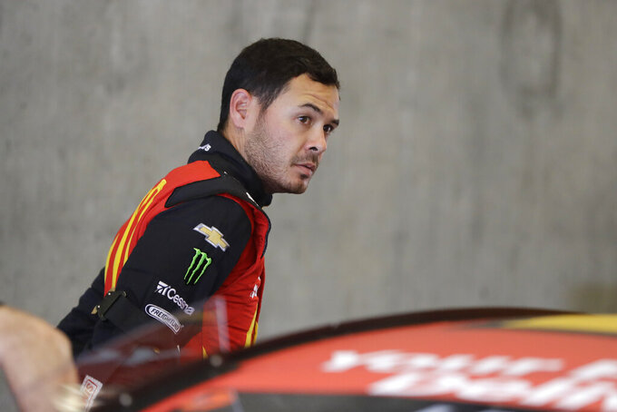 Monster Energy NASCAR Cup Series driver Kyle Larson climbs out of his car during practice for the NASCAR Brickyard 400 auto race at the Indianapolis Motor Speedway, Saturday, Sept. 7, 2019 in Indianapolis. (AP Photo/Darron Cummings)