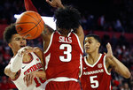 Georgia's Toumani Camara (10) throws a pass around Arkansas guard Desi Sills (3) during an NCAA college basketball game in Athens, Ga., Saturday, Feb. 29, 2020. (Joshua L. Jones/Athens Banner-Herald via AP)