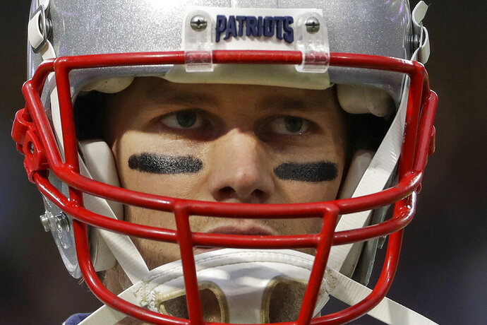 "FILE - In this Feb. 4, 2018, file photo, New England Patriots quarterback Tom Brady warms up before the NFL Super Bowl 52 football game against the Philadelphia Eagles in Minneapolis. Brady, the centerpiece of the New England Patriots' championship dynasty over the past two decades, appears poised to leave the only football home he has ever had. The 42-year-old six-time Super Bowl winner posted Tuesday, March 17, 2020, on social media ""my football journey will take place elsewhere."" The comments were the first to indicate the most-decorated player in NFL history would leave New England. (AP Photo/Matt Slocum, File)"