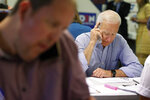 Former Vice President and Democratic presidential candidate Joe Biden calls during a campaign phone bank event an electrical workers union hall Saturday, July 20, 2019, in Las Vegas. (AP Photo/John Locher)
