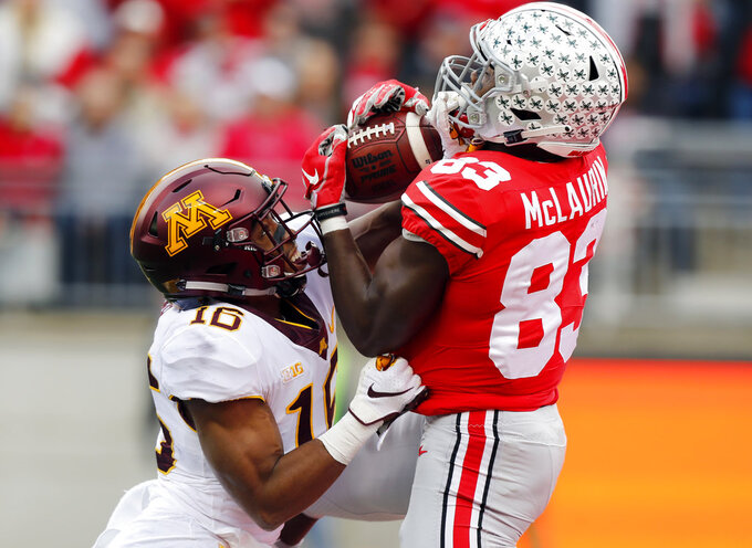 Ohio State receiver Terry McLaurin, right, catches a touchdown pass over Minnesota defensive back Coney Durr during the first half of an NCAA college football game Saturday, Oct. 13, 2018, in Columbus, Ohio. (AP Photo/Jay LaPrete)