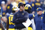 FILE - In this Saturday, Oct. 5, 2019, file photo, Michigan head coach Jim Harbaugh watches during the second half of an NCAA college football game against Iowa in Ann Arbor, Mich. Harbaugh sent an email to parents of players on his team, refuting a report saying representatives are working on his departure from the school. (AP Photo/Paul Sancya, File)