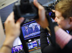 Journalists take photographs of the television broadcast monitors in the press room of the White House in Washington of Attorney General William Barr speaks alongside Deputy Attorney General Rod Rosenstein, right, and Deputy Attorney General Ed O'Callaghan, rear left, about the release of a redacted version of special counsel Robert Mueller's report April 18, 2019, Thursday, April 18, 2019, in Washington. (AP Photo/Pablo Martinez Monsivais)