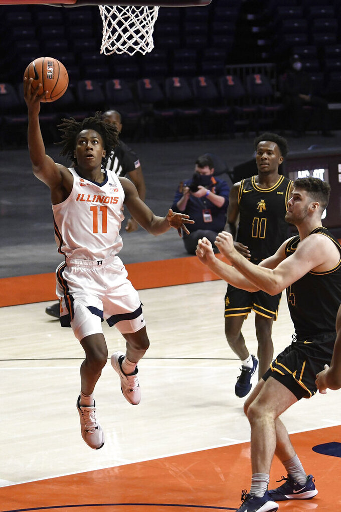 Illinois' Ayo Dosunmu (11) lays the ball in the basket as North Carolina A&T's Tyler Maye (11) and Harry Morrice (14) defend in the first half of an NCAA college basketball game Wednesday, Nov. 25, 2020, in Champaign, Ill. (Photo/Holly Hart)