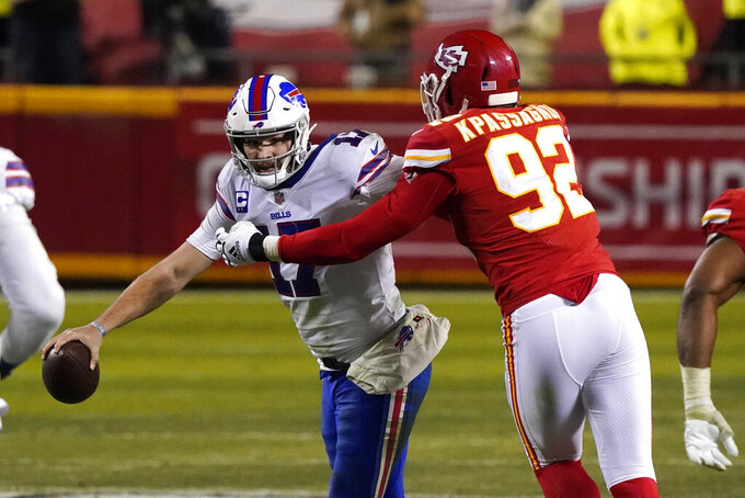 Buffalo Bills quarterback Josh Allen is sacked by Kansas City Chiefs defensive end Tanoh Kpassagnon (92) during the second half of the AFC championship NFL football game, Sunday, Jan. 24, 2021, in Kansas City, Mo. (AP Photo/Jeff Roberson)