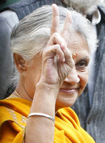 FILE - In this Nov. 29. 2008 file photo, Delhi state Chief Minister Sheila Dikshit gestures after casting her vote in New Delhi, India. Dikshit, an Indian politician who was New Delhi's longest-serving chief minister, has died after a prolonged illness on Saturday, July 20, 2019. She was 81. (AP Photo/Mustafa Quraishi, File)