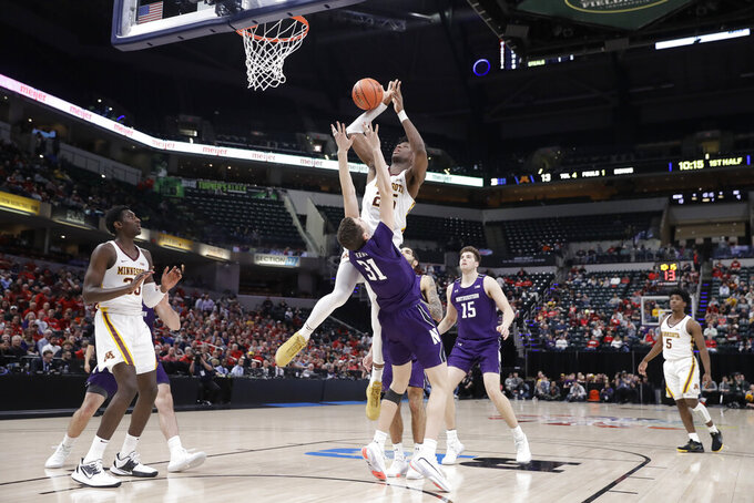 Northwestern's Robbie Beran (31) is called for a foul against Minnesota's Daniel Oturu (25) during the first half of an NCAA college basketball game at the Big Ten Conference tournament, Wednesday, March 11, 2020, in Indianapolis. (AP Photo/Darron Cummings)