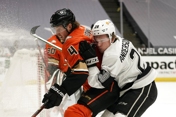Los Angeles Kings' Jaret Anderson-Dolan, right, collides with Anaheim Ducks' Cam Fowler during the first period of an NHL hockey game Saturday, May 1, 2021, in Anaheim, Calif. (AP Photo/Jae C. Hong)