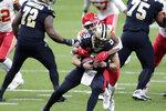 Kansas City Chiefs cornerback L'Jarius Sneed (38) brings down New Orleans Saints quarterback Drew Brees (9) in the first half of an NFL football game in New Orleans, Sunday, Dec. 20, 2020. (AP Photo/Brett Duke)