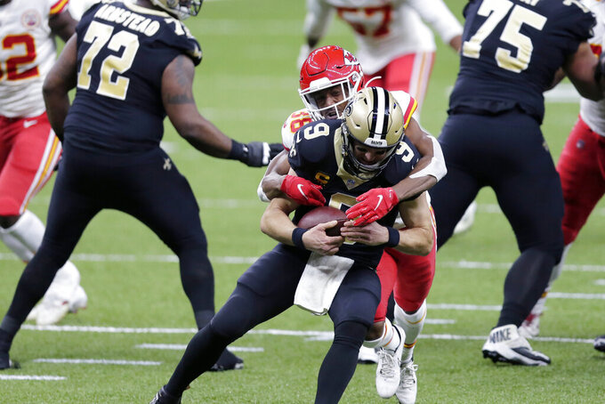 Kansas City Chiefs cornerback L'Jarius Sneed (38) brings down New Orleans Saints quarterback Drew Brees (9) in the first half of an NFL football game in New Orleans, Sunday, Dec. 20, 2020. (AP Photo/Brett Duke)
