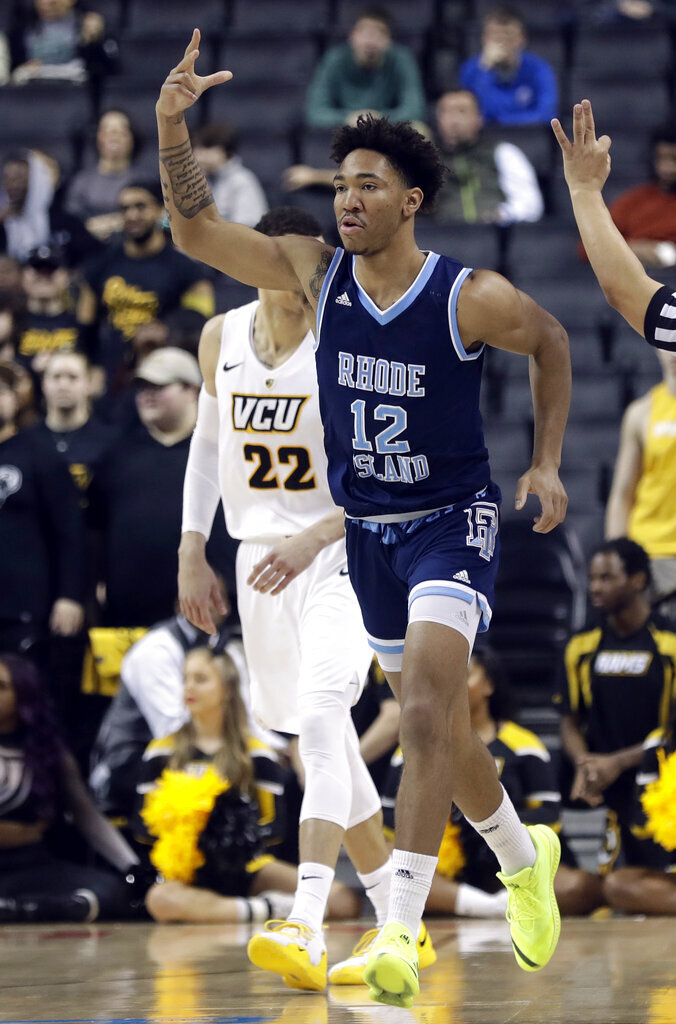 Rhode Island's Dana Tate (12) reacts after making a three point basket during the first half of an NCAA college basketball game against VCU in the Atlantic 10 men's tournament Friday, March 15, 2019, in New York. (AP Photo/Frank Franklin II)