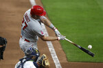 Los Angeles Angels' Mike Trout connects for a two-run home run against the Seattle Mariners in the sixth inning of a baseball game Wednesday, Aug. 5, 2020, in Seattle. (AP Photo/Elaine Thompson)