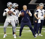 Dallas Cowboys quarterback Dak Prescott (4) and quarterbacks coach Jon Kitna, center, prepare to throw passes as quarterback Mike White (3) looks on during drills at the team's NFL football training facility in Frisco, Texas, Wednesday, June 12, 2019. (AP Photo/Tony Gutierrez