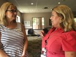 Lisa Zappia, left,chief executive officer of mental health and addiction treatment services provider Prestera Center, speaks with Prestera addictions counselor Kim Miller Wednesday, July 21, 2021, at the nonprofit group's headquarters in Huntington, W.Va. In one of the epicenters of the U.S. opioid explosion, the nonprofit group really could use some money. Whether from a potential national settlement deal with big U.S. drug distribution companies or from some other source, an infusion of cash would help stem the tide of losses in staffing and other areas in recent years, along with the strain caused by the coronavirus pandemic. (AP Photo/John Raby)