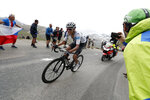 Colombia's Egan Bernal wearing the best young rider's white jersey climbs Iseran pass during the nineteenth stage of the Tour de France cycling race over 126,5 kilometers (78,60 miles) with start in Saint Jean De Maurienne and finish in Tignes, France, Friday, July 26, 2019. Tour de France organizers stopped Stage 19 of the race because of a hail storm as Julien Alaphilippe lost his yellow jersey to Egan Bernal. (AP Photo/Thibault Camus)