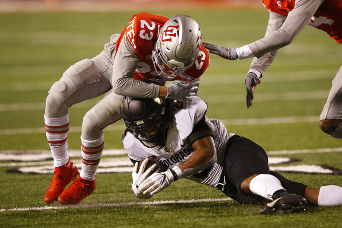 Utah defensive back Julian Blackmon (23) tackles Colorado wide receiver Laviska Shenault Jr., bottom, in the second half during an NCAA college football game Saturday, Nov. 30, 2019, in Salt Lake City. (AP Photo/Rick Bowmer)