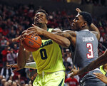 Texas Tech's Deshawn Corprew (3) blocks a shot by Baylor's Flo Thamba (0) during the first half of an NCAA college basketball game Saturday, Feb. 16, 2019, in Lubbock, Texas. (AP Photo/Brad Tollefson)