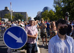 People attend a protest against pollution and the exploitation of a lithium mine in western part of the country, in Belgrade, Serbia, Saturday, Sept. 11, 2021. Hundreds activists gathered to protest against the exploitation of a lithium mine by international Rio Tinto company. (AP Photo/Darko Vojinovic)