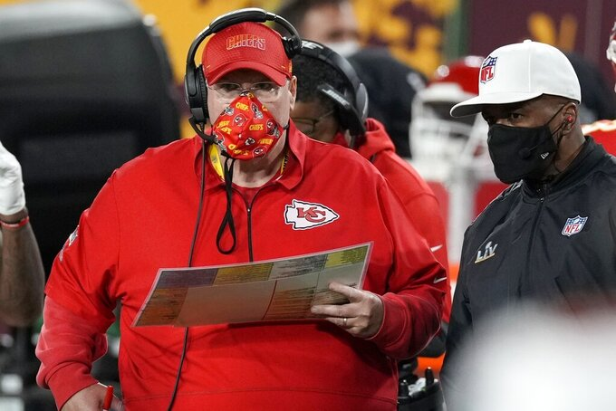 Kansas City Chiefs head coach Andy Reid watches from the sideline during the first half of the NFL Super Bowl 55 football game against the Tampa Bay Buccaneers, Sunday, Feb. 7, 2021, in Tampa, Fla. (AP Photo/Chris O'Meara)