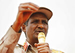 Gen. Mohammed Hamdan Dagalo, the deputy head of the military council, better known as Hemedti, speaks during a military-backed rally, in Mayo district, south of Khartoum, Sudan, Saturday, June 29, 2019. Sudan's ruling generals say they have accepted a joint proposal from the African Union and Ethiopia to work toward a transitional government. (AP Photo/Hussein Malla)