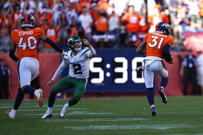 Denver Broncos free safety Justin Simmons (31) intercepts a throw by New York Jets quarterback Zach Wilson (2) during the second half of an NFL football game, Sunday, Sept. 26, 2021, in Denver. (AP Photo/Jack Dempsey)