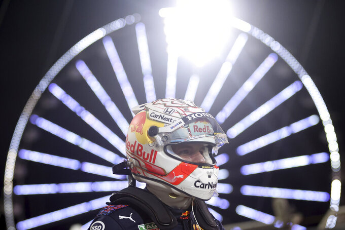 Red Bull driver Max Verstappen of the Netherlands celebrates after the qualifying for the Bahrain Formula One Grand Prix, at the Formula One Bahrain International Circuit in Sakhir, Bahrain, Saturday, March 27, 2021. The Bahrain Formula One Grand Prix will take place on Sunday. (Lars Baron, Pool via AP)