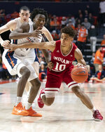 Indiana guard Rob Phinisee (10) drives to the basket against Illinois guard Ayo Dosunmu (11) during the second half of an NCAA college basketball game in Champaign, Ill., Thursday, March 7, 2019. (AP Photo/Stephen Haas)