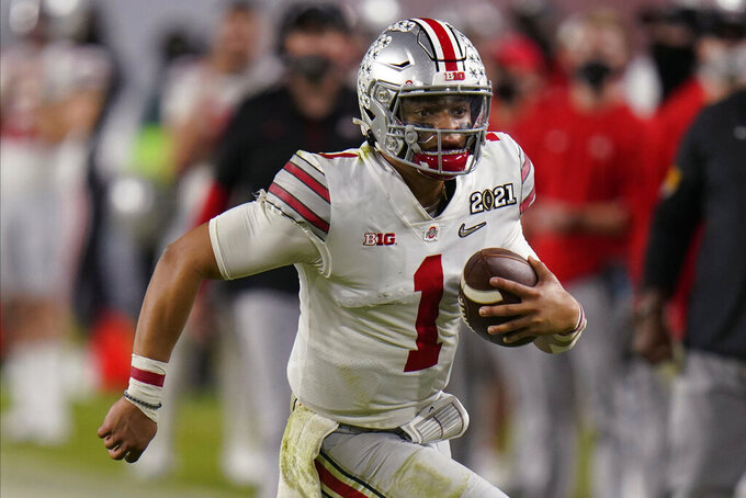 Ohio State quarterback Justin Fields runs against Alabama during the second half of an NCAA College Football Playoff national championship game, Monday, Jan. 11, 2021, in Miami Gardens, Fla. (AP Photo/Chris O'Meara)