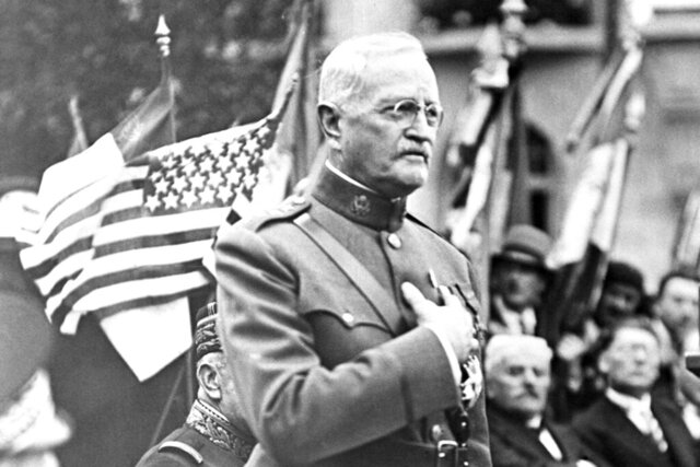 FILE - In this Sept. 15, 1935, file photo, General John J. Pershing makes a speech during the ceremony of planting an oak tree named after him to celebrate his 75th birthday and the 17th anniversary of the battle of St Mihiel, in St Mihiel, France. In the aftermath of World War I, 14 countries competed in the Inter-Allied Games in 1919, in a stadium named for Pershing, commander of the American Expeditionary Force in Europe. (AP Photo/File)