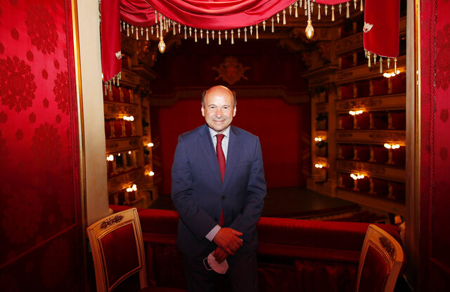 La Scala general manager Dominique Meyer poses at the end of a press conference to present the fall 2020 program of concerts and ballets, in Milan, Italy, Monday, July 27, 2020. The presentation marks the reopening of one of the world's most renown theaters following the coronavirus lockdown as well as support of artists who were left without work during the shutdowns.(AP Photo/Antonio Calanni)