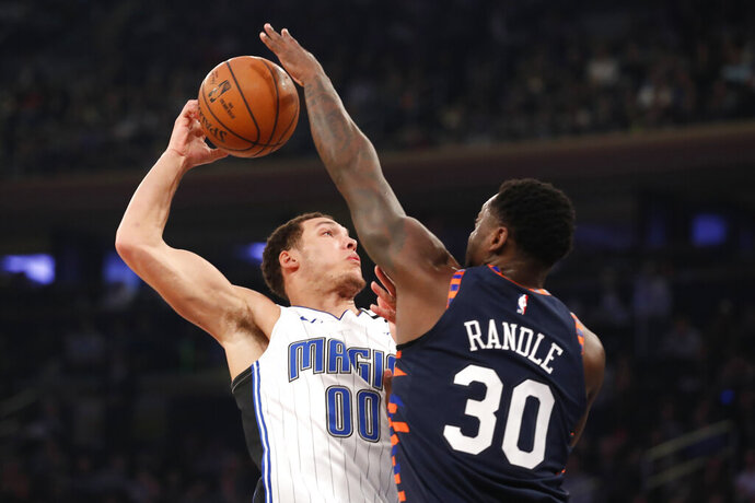 New York Knicks forward Julius Randle (30) blocks the shot of Orlando Magic forward Aaron Gordon (00) during the first half of an NBA basketball game, Thursday, Feb. 6, 2020, in New York. (AP Photo/Michael Owens)