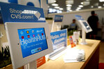 In this Thursday, May 30, 2019 photo, a kiosk is shown inside a CVS store with the new HealthHUB in Spring, Texas. HealthHUB locations offer a broader range of health care services, new product categories, digital tools and on-demand health kiosks, trusted advice and personalized care. (AP Photo/David J. Phillip)