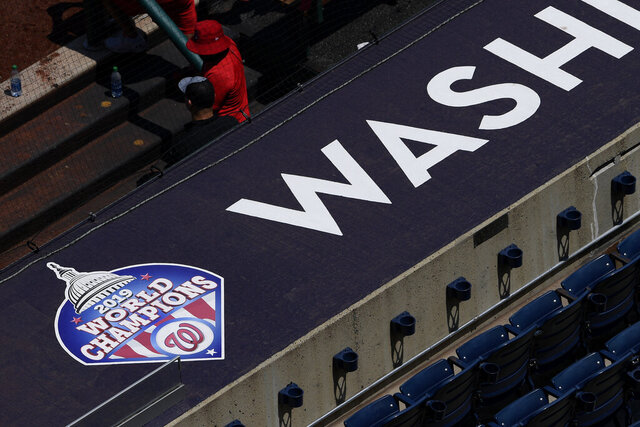 A 2019 World Series champions logo displayed is seen on the top of the dugout during the Washington Nationals baseball practice at Nationals Park, Wednesday, July 22, 2020, in Washington. (AP Photo/Nick Wass)