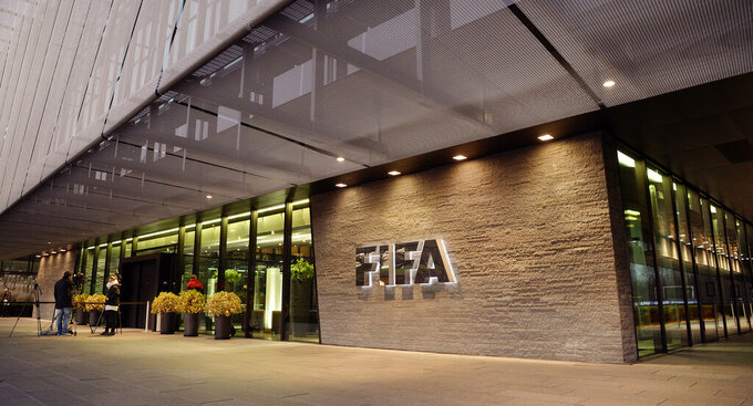 FILE - This Wednesday, Dec. 2, 2015 file photo shows the FIFA Headquarters in Zurich, Switzerland. The FIFA ethics committee has 13 formal investigations ongoing, plus preliminary enquiries in 62 more cases, the soccer body's lawyers said Tuesday June 23, 2020, during a two-day online review. (Walter Bieri/Keystone via AP, File)