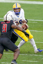 Pittsburgh quarterback Joey Yellen (16) is sacked and loses the ball by Austin Peay defensive tackle Josephus Smith (44) during the second half of an NCAA college football game, Saturday, Sept. 12, 2020, in Pittsburgh. Pittsburgh recovered the fumble on the play. (AP Photo/Keith Srakocic)