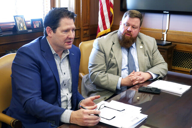 Kansas House Speaker Ron Ryckman Jr., left, R-Olathe, speaks to reporters as Speaker Pro Tem Blaine Finch, R-Ottawa, listens, Thursday, Feb. 27, 2020, at the Statehouse in Topeka, Kan. Lawmakers have finished the first half of their annual, 90-day session and have left their first big votes on the budget, cutting income taxes and legalizing medical marijuana until the second half. (AP Photo/John Hanna)