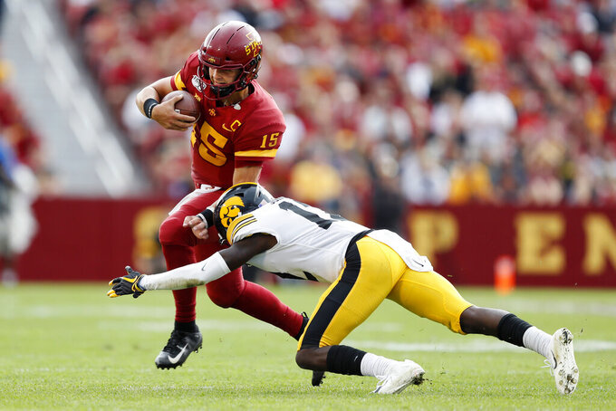 Iowa State quarterback Brock Purdy (15) is tackled by Iowa defensive back D.J. Johnson, right, during the first half of an NCAA college football game, Saturday, Sept. 14, 2019, in Ames, Iowa. (AP Photo/Charlie Neibergall)