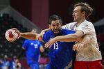 France's Nikola Karabatic makes a shot during the men's gold medal handball match between France and Denmark at the 2020 Summer Olympics, Saturday, Aug. 7, 2021, in Tokyo, Japan. (AP Photo/Sergei Grits)
