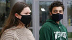 While wearing protective masks due to the COVID-19 outbreak, Lucy Vitali, who portrays Juliet, left, stands with Alex Mansour, who portrays Romeo, outside the auditorium after working on their virtual performance of Shakespeare's