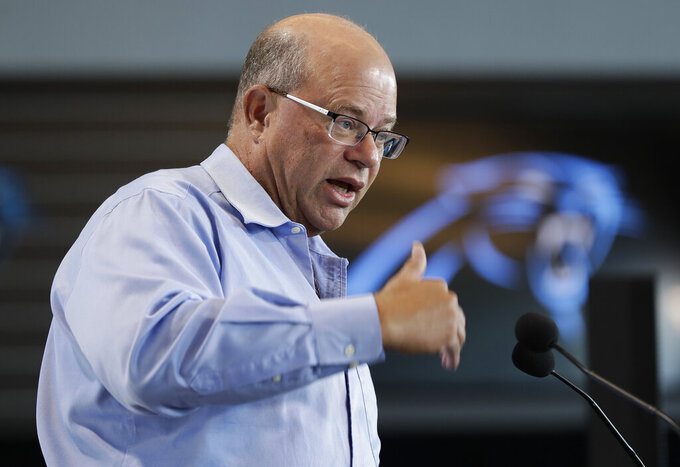 FILE - In this July 10, 2018 file photo, New Carolina Panthers owner David Tepper answers a question during a news conference at Bank of America Stadium in Charlotte, N.C. The South Carolina Senate appears to be preparing for a key vote on whether to give the Carolina Panthers tax breaks and incentives to move their practice fields out of South Carolina. State Sen. Dick Harpootlian removed his objection on the bill Tuesday, May 7, 2019, so it could come to a vote.  (AP Photo/Chuck Burton, File)