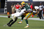 New Orleans Saints outside linebacker Demario Davis, left, breaks up a pass intended for Green Bay Packers tight end Robert Tonyan during the first half of an NFL football game, Sunday, Sept. 12, 2021, in Jacksonville, Fla. (AP Photo/Stephen B. Morton)