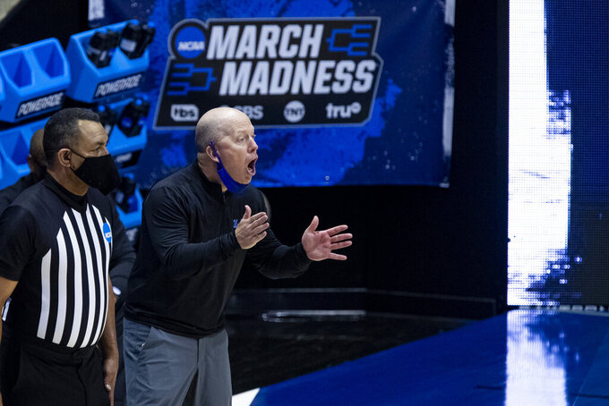 UCLA coach Mick Cronin yells to players during the second half of a First Four game against Michigan State in the NCAA men's college basketball tournament Thursday, March 18, 2021, at Mackey Arena in West Lafayette, Ind. UCLA won 86-80. (AP Photo/Robert Franklin)