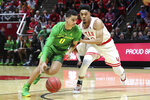 Oregon guard Will Richardson (0) dribbles the ball past Utah guard Sedrick Barefield (2) during the first half of an NCAA college basketball game Thursday, Jan. 31, 2019, in Salt Lake City. (AP Photo/Chris Nicoll)