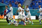Finnish players warm up prior to the Euro 2020 soccer championship group B match between Russia and Finland at the Saint Petersburg stadium, in St. Petersburg, Russia, Wednesday, June 16, 2021. (AP Photo/Dmitri Lovetsky, Pool)